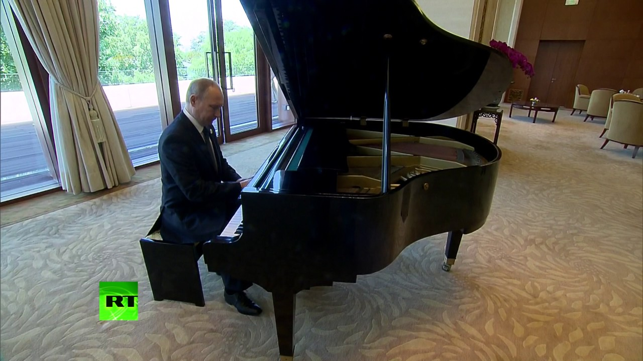 Putin plays piano at Xi Jinping's residence during forum in Beijing
