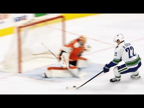 Video: Daniel Sedin dekes, slides puck past pad of Michal Neuvirth