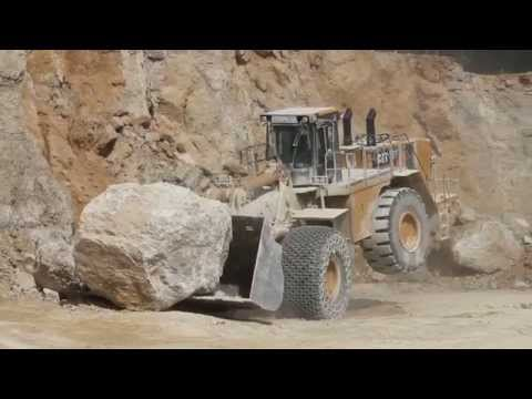 Caterpillar CAT 992K plays with a Big Stone