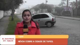 NÉVOA COBRE A CIDADE DE TAPES.