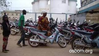 People Arrive On Motorcycles