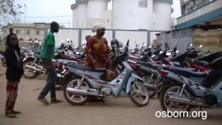People Arrive On Motorcycles