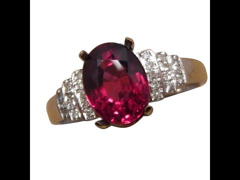Oval Garnet and Diamond Ring for women.  2.6 Carat Rich Red stone.