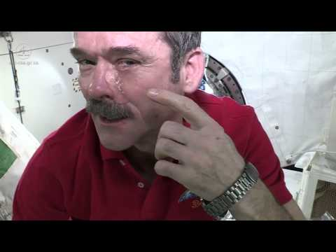Crying - ISS commander Chris Hadfield demonstrates what happens to tears if they start 'falling' in Space.