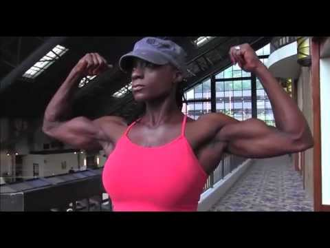 Muscle Woman flexing her strong biceps