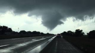Giddings (TX) United States  city photos gallery : tornado crossing the road in Giddings, TX