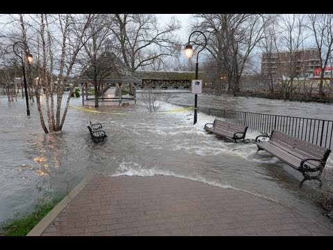 Naperville - After Opening the flood gates at McDowell woods last night 4/18/13 at 6:30 PM the river rose and closed the Washington,Main,Eagle and Jefferson street bridge...