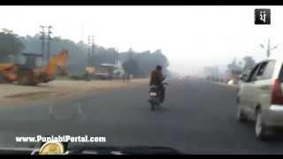 Bike Stunts While Chatting On Mobile