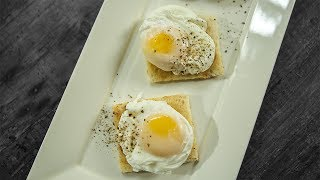 Learn How To Make Perfect Poached Eggs Recipe, an English Breakfast recipe from Chef Varun Inamdar. Make this delicious Egg Recipe in a simple, quick and easy method, at your home and share your experience with us in the comments below.Ingredients:-Sliced bread & butter for toasting6 eggs1 ltr. Water⅛ cup White VinegarSaltCrushed black pepperMethod:-- Break open eggs in ceramic bowls.- In a pan add water, white vinegar, salt and bring to a boil.- Once the water is boiled turn the flame off and wait for 30 seconds.- After 30 seconds turn the flame on to medium and stir the water.- Drop the eggs one by one in the water carefully as the water stirs.- Once done, take out on a plate.Perfect Poached Eggs ready to eat with Butter Toasted Bread! HAPPY COOKING!!!Host: Varun InamdarDirector: Vaibhav DhandhaCamera: Pratik Gamre, Spandan Rout, Shashank AlshiEditing: Dinesh ShettyProducer: Rajjat A. BarjatyaCopyrights: Rajshri Entertainment Pvt LtdSubscribe and Get regular Updates: http://www.youtube.com/user/getcurried?sub_confirmation=1https://www.facebook.com/GetCurriedhttps://plus.google.com/+getcurriedhttps://twitter.com/Get_Curriedhttps://instagram.com/getcurried