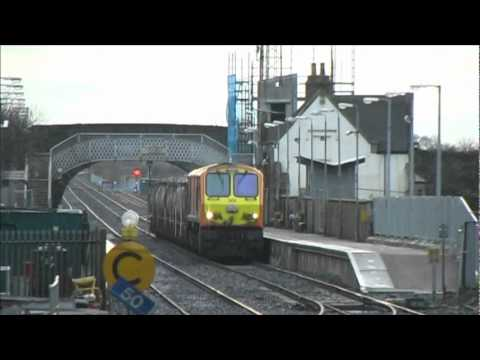 Dublin Cork Line - Iarnród Éireann's class leader No.201 takes a Cork-Dublin North wall (and onwards to Platin, Co. Meath) empty cement train, comprised of thirteen four-wheele...