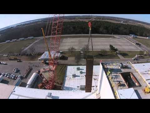 Carl A. Nelson & Co. crane picking up 74,000 lb sterilizer