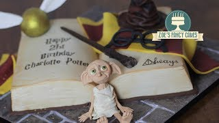 How to make a book cake. I use my book cake to create a Harry Potter themed cake, but with this basic cake decorating tutorial you can learn how to create a book cake, which you can then use to make any themed cake, just by adding relevant colours and cake toppers!I do have tutorials on making some of the Harry Potter cake toppers shown in this video, you can find the links below.Dobby cake topper tutorial - https://youtu.be/e2vvh-6eEwcSorting hat cake topper tutorial - https://youtu.be/rmdLIF9UYQwTools and products used in this video - Rainbow dust chocolate - http://amzn.to/2rLQXJGCake modelling tool - https://www.facebook.com/commerce/products/1878762348816211/Craft mat - http://amzn.to/2dMKpl9Chocolate fondant - http://amzn.to/2tnLnKXEdible gold stars - http://amzn.to/2tMkAbdBasic Victoria sponge cake recipe - Ingredients: 225g butter225g caster sugar4 eggs225g self-raising flour 1 tsp vanilla essenceMethod:Cream together the butter and sugar, then beat in the eggs and vanilla essence. Once smooth and creamy, fold in the flour.Pour in to a greased cake tin and bake in the oven at 180degrees for approximately 40 minutes, until golden brown and a knife comes out clean.Buttercream recipe - 600g icing sugar, sifted300g unsalted or salted butter, softenedoptional flavouringBeat the ingredients together.To see more of my cakes and creations please visit my pages below-Facebook https://www.facebook.com/zoesfancycakes Twitter https://twitter.com/zoesfancycakesInstagram https://instagram.com/zoesfancycakes/Website http://www.zoesfancycakes.co.uk/You can also check out my online courses with 25% off below! :)Faces - https://www.udemy.com/how-to-make-sugar-craft-faces/?couponCode=YT25OFFRoses - https://www.udemy.com/how-to-make-sugar-craft-roses/?couponCode=YT25OFF
