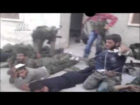war criminal - FSA and Al-Nusra terrorists tried to get rid of unplasant witnesses of their use of chemical weapons against the Syrian civilians in March 2013...by executin...