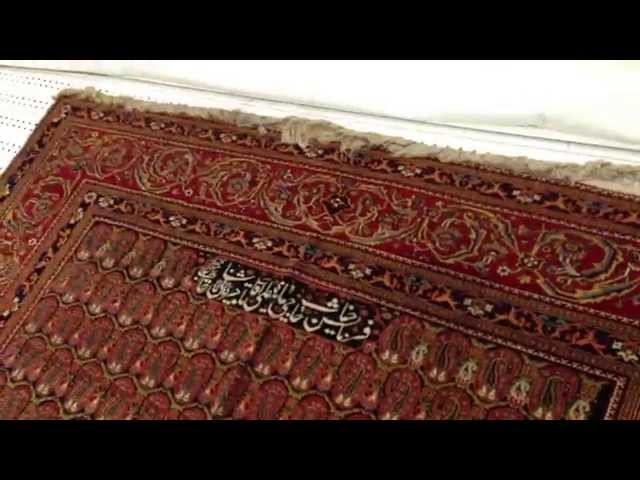 Mashhad Carpet Museum  closed view of Mohtasham antique carpet in museum