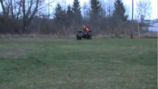 6. 2004 yamaha bear tracker side wheelies