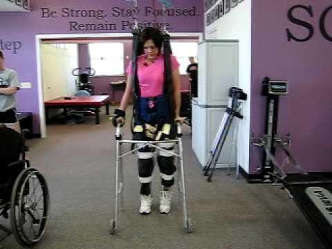 Heather walking with braces and walker 5052010.AVI