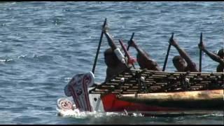 A fleet of Epois, the Kula Canoes of Esaala, race to Alotau as part of the 2007 Milne Bay Canoe and Kundu Festival...