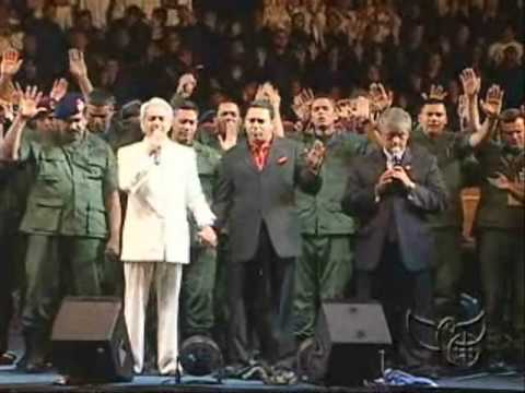 Benny Hinn prays with the Crowd in Venezuela
