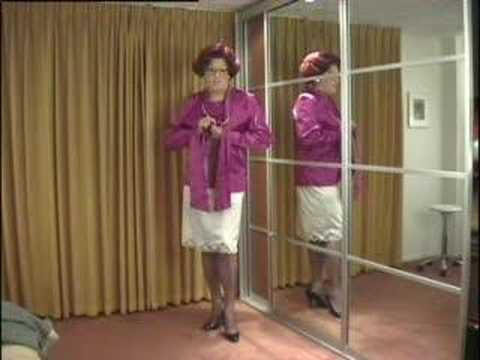 wandanylon - Mrs. Wanda Nylon undressing her purple blouse and skirt, up to her white girdle and nylons.