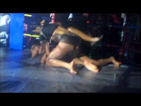 black women vs. white woman bikini oil wrestling