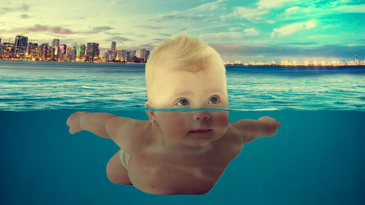 Baby Swimming At Sea