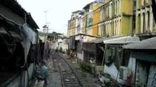 Train Runs Though Bangkok Market (SRT Maeklong Line)