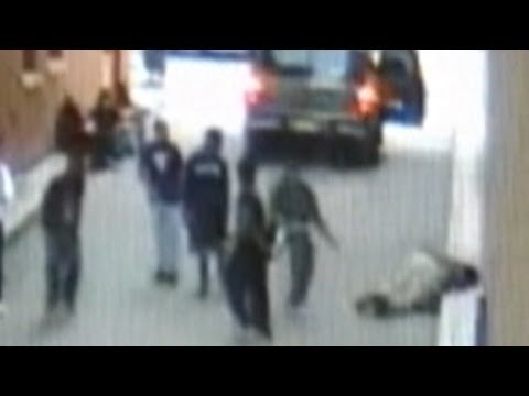 knockout - Police are investigating young people caught on surveillance footage punching innocent people.