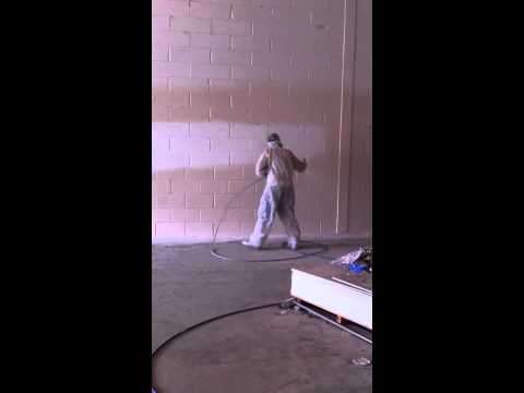 operating a graco 695 - Airless paint spraying some more factory walls.