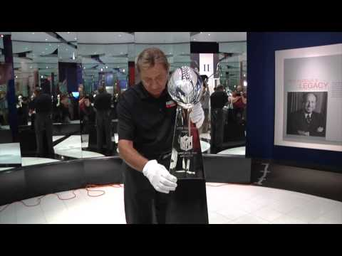 Joe Namath places Super Bowl XLVIII Trophy on Display