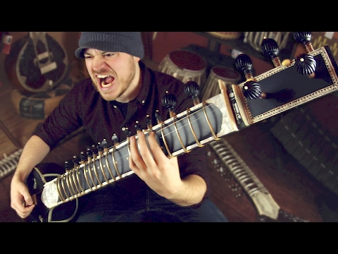 Guitarist Rob Scallon Rocks Out a Heavy Metal Tune on a Gorgeous 19String