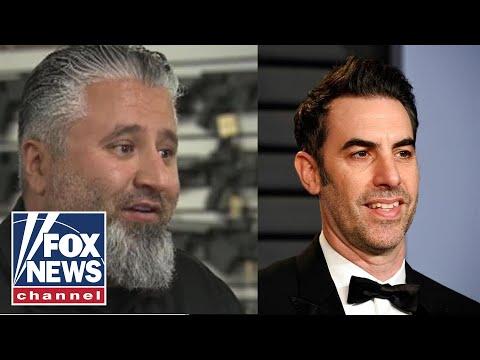 Gun shop owner confronts disguised Sacha Baron Cohen