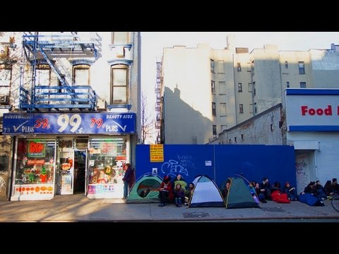 99 - 100 people camp out in front of the dollar store on Black Friday. Full story: http://improveverywhere.com/2012/11/26/black-friday-dollar-store/ Like us on Fa...