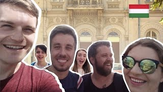 ► Facebook Group: http://bit.ly/MagyarWeasels► Meet-Up Information: http://bit.ly/MagyarMeetUp---- ↓↓↓ Click 'SHOW MORE' below to see more information ↓↓↓► Feliratkozás: http://bit.ly/TravellingWeasels► Subscribe: http://bit.ly/TravellingWeaselsWe have arrived in Hungary! Not only that, but we had the BEST arrival we have ever had! If you haven't seen it yet, watch Vlog number one here: https://youtu.be/hg1u-WYajHUToday we spoke some Hungarian in Budapest, we got interviewed by 24.hu! Special thanks to Két Lotti and also to the 2 fans who recognised us after the interview! Join our Facebook Group for more information on upcoming meet-ups: http://bit.ly/MagyarWeasels Also, read the blog post for all our meet-up dates: http://bit.ly/MagyarMeetUpHave you seen all the 'Speaking Hungarian' videos? Watch them now:PART 1: https://youtu.be/FsKQEPJXKJMPART 2 Megszentségteleníthetetlenségeskedéseitekért: https://youtu.be/-IXg4NR9zaUPART 3 Hungarian Tongue Twisters: https://youtu.be/VXS0RLTm8_gPART 4 A Magyar ÁBÉCÉ: https://youtu.be/MnU7jC7QJAMPART 5 ANGOLOK MAGYARUL: https://youtu.be/RgI88oSpYlIPART 6 NEMZETI ÜNNEP: https://youtu.be/_hspDZgFcOUPART 7 SZÁMOK: https://youtu.be/QeXL5r6AcFUPART 8 KASSZÁS ERZSI: https://youtu.be/4l_iKWieOd0PART 9 ÁLLATOK: https://youtu.be/ds-Q7uPlFnUPART 10 MAGYAR YOUTUBERS: https://youtu.be/0KwPpTBh4pIPART 11 MAGYAR MUSIC: https://youtu.be/WTLwXYxecdkPART 12 ÉTEL: https://youtu.be/H6TVecbZTggPART 13 JOCI PÁPAI: https://youtu.be/DxMrycK-aVIPART 14 MAGYAR APP: https://youtu.be/YQeYLQ0h7JMPART 15 MAGYAR ROCK: https://youtu.be/fxVcwjJxASM PART 16 TMI TAG: https://youtu.be/uqiBJ0eu9OsPART 17 YOUTUBERS: https://youtu.be/SE4t8Y3-82kPART 18 TALÁMÁNYOK: https://youtu.be/alTZQydU__MPART 19 PALVIN BARBARA: https://youtu.be/aabjW0tDi10► Watch our Hungary Playlist here (WE VISITED HUNGARY!): http://bit.ly/HungaryPlaylist 🇭🇺► All Speaking Hungarian Videos: https://youtu.be/FsKQEPJXKJM?list=PLd5RMUGwfy3ss-4hQ6sHOxGLMPOTtu_89► Binge-watch our videos to get to kn
