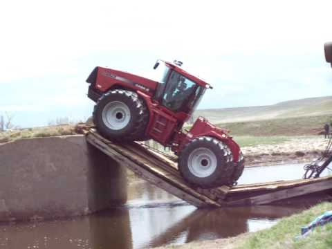 Tractor on bridge cave-in