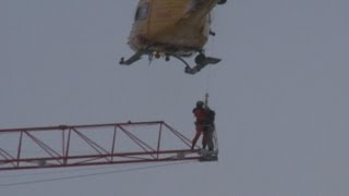 Helicopter plucks crane worker to safety high above fire in Canada