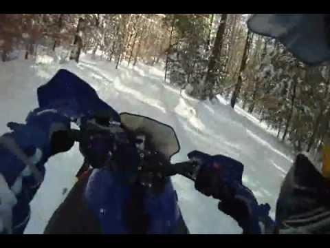 Yamaha nytro on a  fast groomed trail