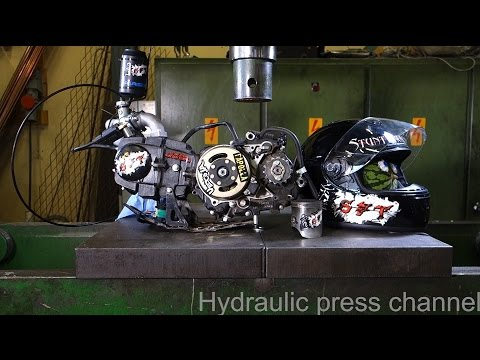 Crushing a Motorcycle Helmet with a Hydraulic