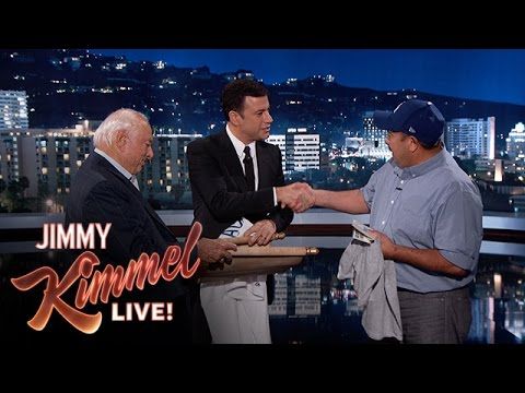 Jimmy Kimmel and Tommy Lasorda reward the man who rescued the 73 year old from the burning house earlier this week