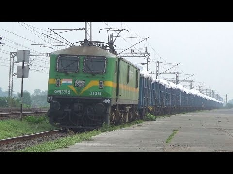 31318/WAG-9 Locomotive leading a long overloaded Freight Train at Talit Railway Station