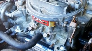 """Replacing my old Rochester Quadrajet with an Edelbrock 1406 carburetor.  This is a 1984 Chevy K20 3/4, just a yard truck for plowing my property.  The old Quadrajet got gunked up from a broken fuel filter so I decided to try swapping on this old Edelbrock.  I had pulled this Edelbrock off an El Camino with a 305 I had about 10 years ago and it has been sitting since.  I popped the top and cleaned the inside, also flushed the passages with carb cleaner.  Seems to run well.The Edelbrock 4bbl is not a direct bolt on to the stock intake manifold.  It has a slightly wider bolt pattern and the shape of the openings is different.  To facilitate installation I bought the Edelbrock adapter kit model 2696 which was less than $30.  It includes the adapter plate, two gaskets, and mounting hardware.I also purchased for about $8 the Edelbrock 8009 throttle cable adapter kit which allows the stock GM throttle cable to interface easily to the Edelbrock caburator armature.The biggest adaption here was the fuel line.  The Rochester Quadrajet has the fuel filter in the the front of the carburetor and is fed by a metal fuel line that threads in there.  The Edelbrock's fuel inlet accepts a rubber line and is on the side towards the rear.  I cut my metal fuel line and attached a rubber line to it with an inline fuel filter to the Edelbrock 1406.  This seemed to work very well.I had to extend my PCV hose about an inch.  This was easily done by cutting it and splicing with a piece of metal tubing.  The brake booster vacuum line on the rear of both carbs is identical and required no modification.  Same with the distributor vacuum advance, same location on both carburetors.Parts Used:Edelbrock 2696 adapter plate kitEdelbrock 8009 throttle cable adapterRubber fuel lineInline fuel filterHose clampsTools:Flat head screwdriverPhillips screw driver5/8"""" tubing wrench (fuel line and brake booster fitting)1/2"""" wrench (carb mounting bolts)3/4"""" wrench to swap brake booster fitting Something to cut fue"""