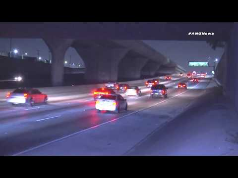 Drivers attempting to dodge a disabled vehicle in the middle of a dark interstate.