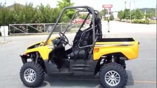 6. 2013 Kawasaki Teryx 750 FI 4x4 Sport In Sunrise Yellow At Tommy's MotorSports