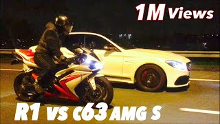 Street race within the legal speed limits of the country!! Between a Yamaha yzf R1 and a Mercedes C63 AMG S amazing awesome fantastic insane crazy outrageous...