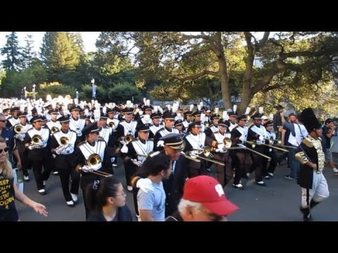 kevinsyoza - University of California Marching Band, Dance Team, Cheerleaders, Mic Men, and Rally Committee march through the UC Berkeley campus towards Memorial Stadium ...