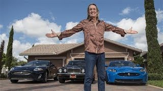 Nicko McBrain, the drummer for the band Iron Maiden, drives a custom Jaguar XKR-S adorned with the band's font and painted a ...