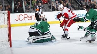 Detroit Red Wings forward Tomas Tatar splits the defense and avoids them colliding before scoring a crazy goal on Dallas Stars goalie Kari Lehtonen.