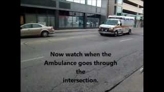 Ambulance almost hit by car