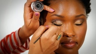 Watch more How to Do Makeup for Black Women videos: http://www.howcast.com/videos/501638-Best-Products-for-Black-Skin-Black-Women-MakeupSo one of my favorite products for African American skin is the William Tuttle spot cover. I love it. It's like a pot of magic coal and it really works to help with correcting dark circles.So if you suffer with dark circles and you want them gone for good, or at least temporarily when you go out at night, then you need to invest in the William Tuttle spot cover. It's really a great product for covering those dark circles.So the Embryolisse Hydrating Cream Mask is really great because it moisturizes the skin and leaves the skin with a really great glow, and hydrates and leaves the skin feeling really supple and soft. And it's really great for applying foundation.So I really love the Laura Mercier Secret Brightening Powder. You put this right under the eye before you do any eye shadows and it really, really makes your eye look really clean and gives you that flawless finish, like Kim Kardashian.OCC lip tars are full of highly concentrated lip color. Wear them bold.  Wear them shear. You can customize and be the master of your own universe. I love them.So the Three Custom Color Concealer Palette is really great for contouring and customizing your own foundation shades.So finally, at the top of my list is the O-Gloss from Smashbox because it intuitively figures out what shade of paint works with your natural lip color.