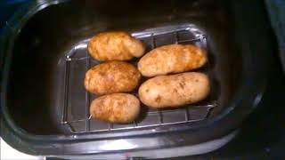 How to bake potatoes in a roster oven in less than an hour; no foil paper needed.