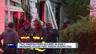 Two firefighters injured fighting house fire